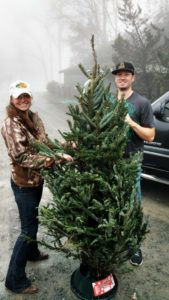 Frankie Lancaster helping Western Youth Network's Festival of Trees