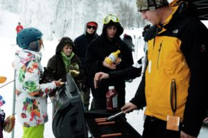 Roasting hot dogs at Appalachian Ski Mountain's event hosted by RECESS