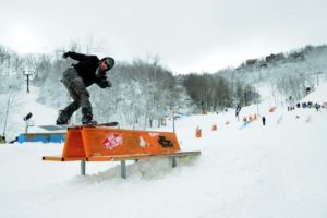 Skier grinds a bench at Appalachian Ski Mountain
